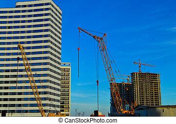 grues, center., yellow., petit, stands, fenetres, blanc, multifonctionnel, ville, suivant, construction, nouveau, secteur, forme, inhabituel, maison