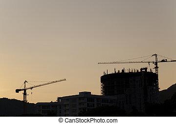 grues, construction, coucher soleil