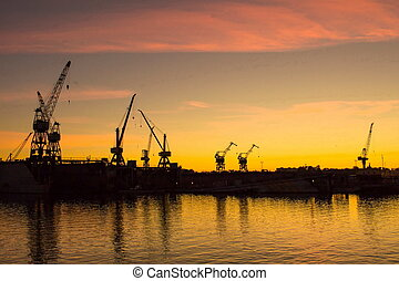 grues, riga, coucher soleil, port