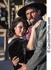 Portrait of an old west woman and sheriff