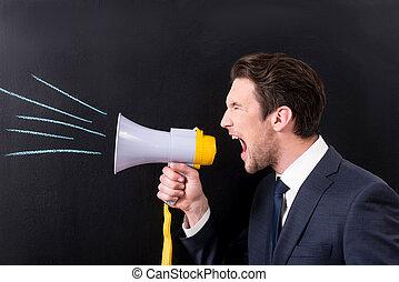 Grumpy businessman is yelling through bullhorn