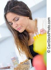 Grumpy woman with orange juice