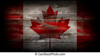 Flag of Canada painted on grungy wood plank
