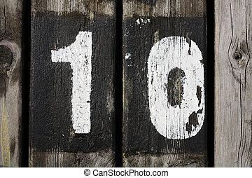 Number 10 painted on wood