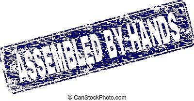 Grunge ASSEMBLED BY HANDS Framed Rounded Rectangle Stamp