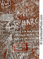 Grunge background with graffiti and writings on a rusty metallic surface