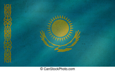 Grunge background with flag of Kazakhstan.