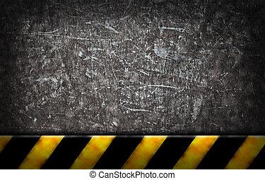 yellow and black sriped warning bar on grunge background