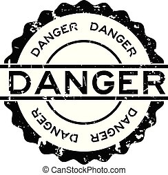 Grunge black danger word round rubber seal stamp on white background