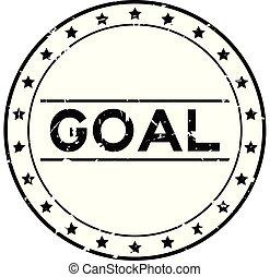 Grunge black goal word round rubber seal stamp on white background