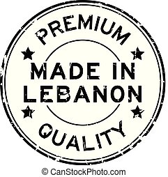 Grunge black premium quality made in Lebanon round rubber seal stamp on white background