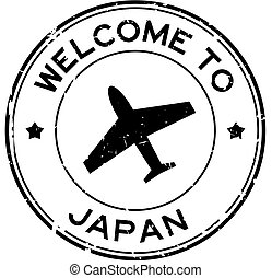 Grunge black welcome to Japan word with airplane icon round rubber seal stamp on white background