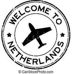 Grunge black welcome to Netherland word with airplane icon round rubber seal stamp on white background