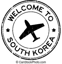 Grunge black welcome to South Korea word with airplane icon round rubber seal stamp on white background