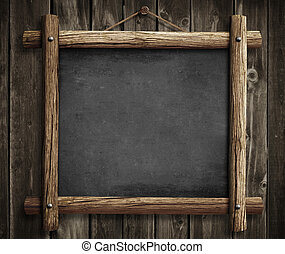 Grunge blackboard hanging on wooden wall as a background
