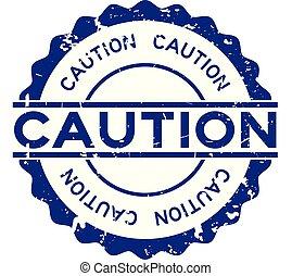 Grunge blue caution word round rubber seal stamp on white background