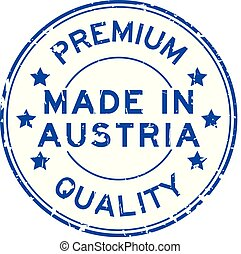 Grunge blue premium quality made in Austria round rubber seal stamp on white background