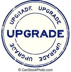 Grunge blue upgrade wording round rubber seal stamp on white background