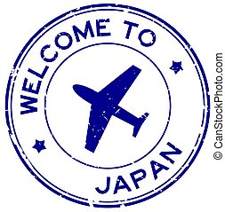Grunge blue welcome to Japan word with airplane icon round rubber seal stamp on white background