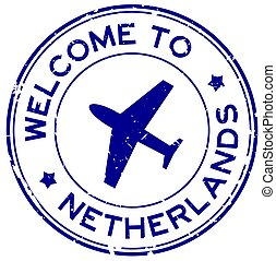 Grunge blue welcome to Netherlands word with airplane icon round rubber seal stamp on white background