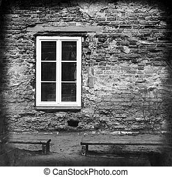 grunge brick wall with a window