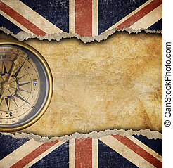 Grunge British flag and old brass compass