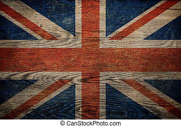 Grunge British flag on wood background