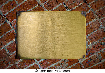 grunge bronze plate with bolts on brick wall background