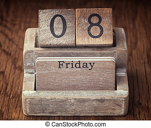 Grunge calendar showing Friday the eighth on wood background