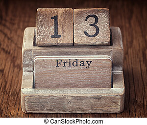 Grunge calendar showing Friday the thirteenth on wood background