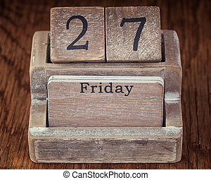 Grunge calendar showing Friday the twenty seventh on wood background