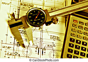 Grunge caliper and calculator over engineering drawing