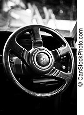 grunge effect classic car steering wheel in black and white ...