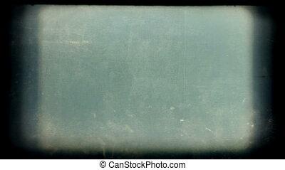 Grunge film frame transition to black. HD.