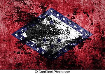 Grunge flag of Arkansas on old paper