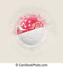Grunge football with flag of singapore