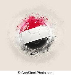 Grunge football with flag of yemen