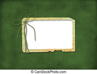 Grunge frame with bow on the green abstrsact background