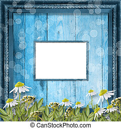 Grunge frame with bunch of flower on the wooden background