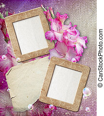 Grunge frame with gladiolus and paper