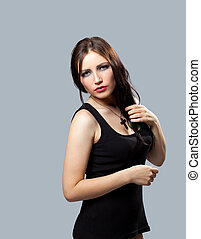Grunge girl in tank top with cross on breast