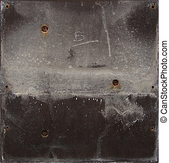 grunge gray black metal plate with screws and leak