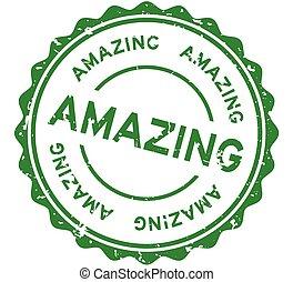Grunge green amazing word round rubber seal stamp on white background
