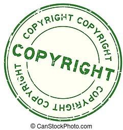 Grunge green copyright round rubber seal stamp on white background