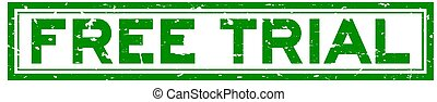 Grunge green free trial word square rubber seal stamp on white background
