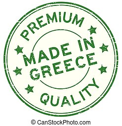 Grunge green premium quality made in Greece round rubber seal stamp on white background