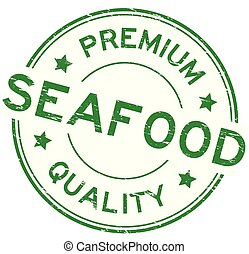 Grunge green premium quality seafood round rubber seal stamp on white background
