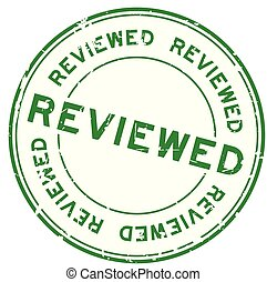 Grunge green reviewed word round rubber seal stamp on white background