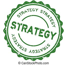 Grunge green strategy word round rubber seal stamp on white background