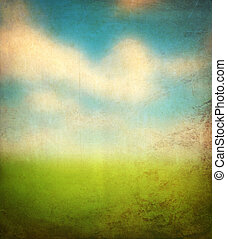grunge image of a field and blue sky